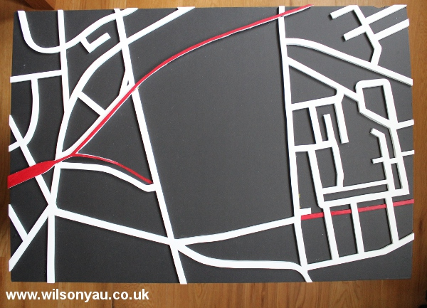 Plan view: Model with all blocks removed to leave only the transport links, roads are in white, railways are in red.