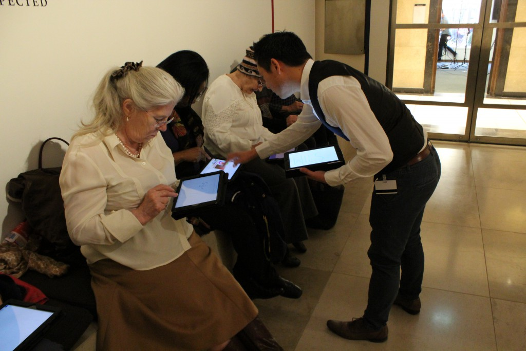 Me leading an iPad drawing workshop with a group of lifelong learners