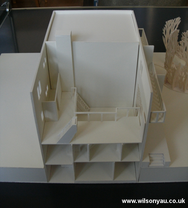 Model with roof and top floor removed to show mezzanine level and double-height living room