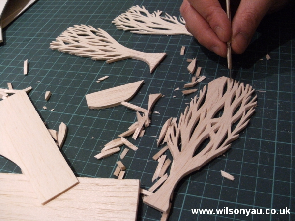 Trees being cut out of balsa wood