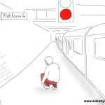 Man tying shoelaces, Farringdon station, London, 3rd May 2013